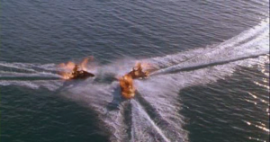 Alas, I wasn't the first to spot the fact that these jet skis are already on fire before they actually collide and explode; someone else already listed it in IMDb's Goofs section.